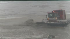Airport snow removal during spring storm, #2 head on. Seond truck passes in bg Stock Footage