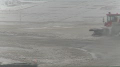 Airport snow removal during spring storm, #3 moving wet sloppy snow Stock Footage