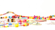 Colorful Plastic Jewellery 02 dolly left Stock Footage