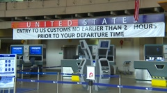 US Customs with sign, airport terminal Stock Footage