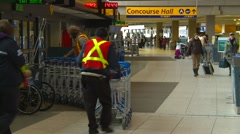 Airport terminal with carts Stock Footage