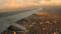 Smooth Aerial of Cape Town Suburbs from Plane Window at Sunset Stock Footage
