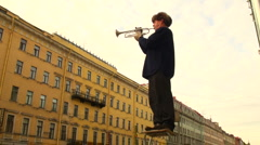 Trumpeter playing in the street Stock Footage