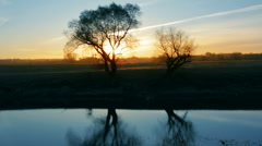 Sunrise landscape with tree and lake Stock Footage