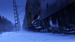 Long cargo train on a snowy day Stock Footage