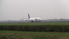 Boeing 737 from Tarom landing at Schiphol - stock footage