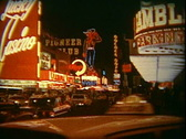 Stock Video Footage of 8mm film archival, 1960s Las Vegas Strip at night the Lucky