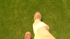 POV Feet Walking On Green Grass - stock footage