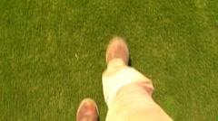 POV Feet Walking On Green Grass Stock Footage