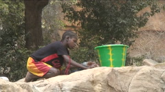 Girl doing the wash Stock Footage