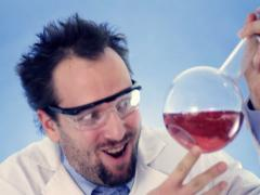 Mad Scientist laughing and holding Volumetric Flask with red liquid Stock Footage