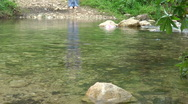 Stock Video Footage of Kziv river at spring. Slow motion. Passage across the river.