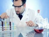 Male scientist in laboratory mixing chemicals in test tubes Stock Footage