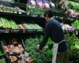 Man Facing Broccoli In Produce SD Footage