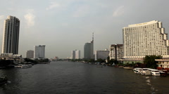 Skyline, Chao Phraya River in Bangkok, Thailand, View from Taksin Bridge, Boats Stock Footage