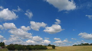 Stock Video Footage of field and time lapse clouds clearing to blue sky