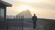 Stock Video Footage of Man Walking Beach Scape 2