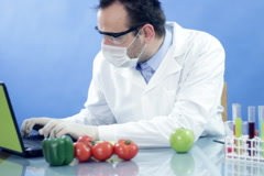 Male scientist in laboratory working on lapto Stock Footage