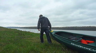 Stock Video Footage of Man with Canoe 1
