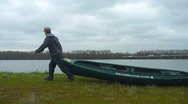Stock Video Footage of Man with Canoe 2