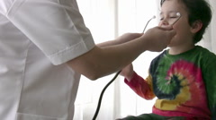 Pediatrician checking Little boy - stock footage