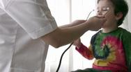 Pediatrician checking Little boy Stock Footage