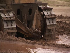 Crawler tractor in the mud Stock Footage
