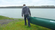 Stock Video Footage of Man with Canoe at River 1