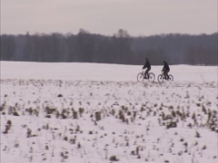 Cyclists in winter Stock Footage