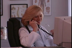 Woman Doctor on the Phone Stock Footage