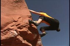 Man rock climbing - stock footage
