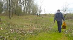 Hiker Walking on Grassy Path 2 Stock Footage