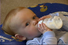 Baby with Bottle Stock Footage