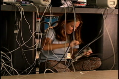 Woman under computer desk Stock Footage