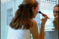 Woman doing Makeup Stock Footage