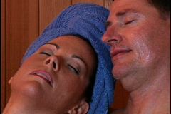 Couple in sauna - stock footage