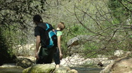 Kziv river at spring. People walking across the spring. Stock Footage