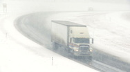 Truck in snowstorm 01 Stock Footage