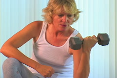 Woman working out Stock Footage