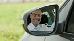 Businessman in car smiling at camera Stock Footage