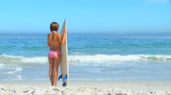 Stock Video Footage of Woman holding her surfboard