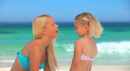 Mother and daughter having fun on the beach Stock Footage