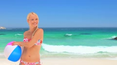 Woman  playing with a beach ball Stock Footage