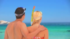 Cute couple wearing snorkels and masks Stock Footage