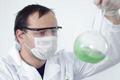 Scientist mixing green liquid in Volumetric Flask  Stock Footage