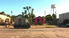 Stock Video Footage of Man Walking In Rundown Neighborhood- Brawley CA