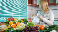 Stock Video Footage of Pregnant woman in kitchen