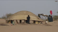 Tuareg woman works at home Stock Footage