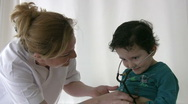 Pediatrician checking Little boy Stock Footage