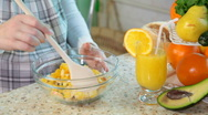 Pregnant woman mixing fruit salad Stock Footage